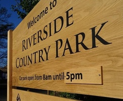 Park entrance welcome sign with time slat
