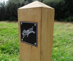 Wooden waymarking post with rubbing plaque