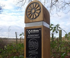 Wooden waymarker post for heritage trail