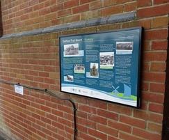 Wall-mounted information board