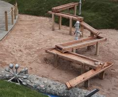 Sand play area with building site and excavator