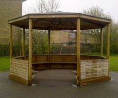 Timber gazebo with shiplap sides and shelved seating
