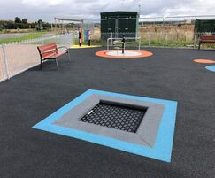 Wheelchair-accessible trampoline in inclusive play area