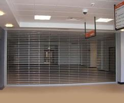 Electrically operated stainless steel rolling grille