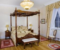 Sunburst four-poster bed