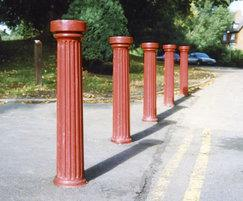Doric cast iron bollards, painted red