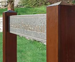 Signage in hardwood and solid surfacing