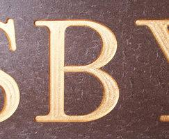 Man-made timber noticeboard lettering