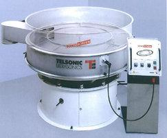 Screening machine fitted with ultrasonic vibrator