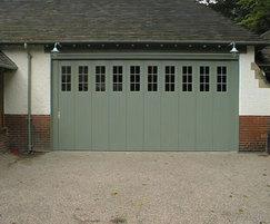 Side-sectional sliding garage doors