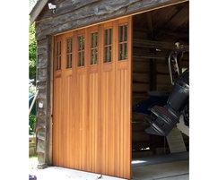 Side-sectional sliding boathouse doors