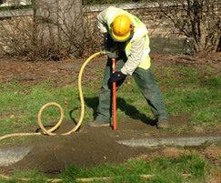 The Air Spade removes soil without damaging roots